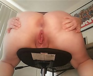 Pissing off of chair from behind