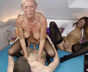 Two Milfs fucked hard with a youthfull Student