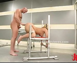 Light-haired sex slave tied on bondage devices